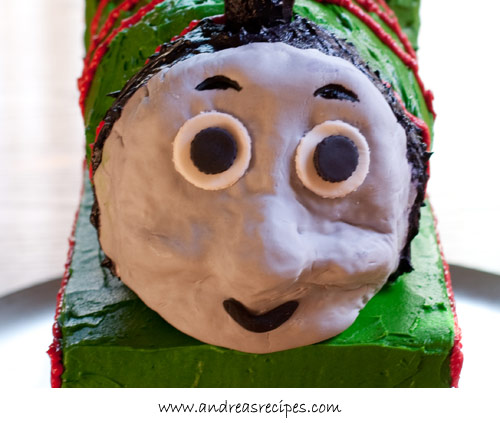 Andrea Meyers - Percy Train Birthday Cake face