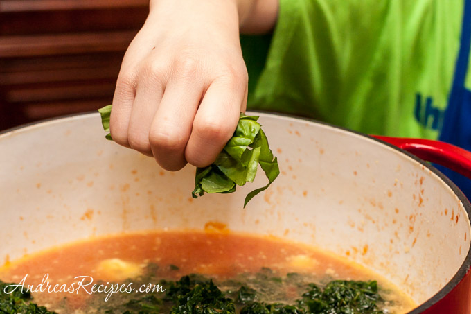 Andrea Meyers - Spinach and Tortellini Soup, add the spinach and basil.
