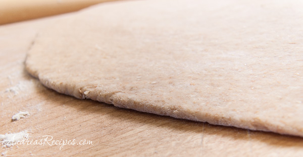 Quick Whole Wheat Pizza Dough, stretched - Andrea Meyers