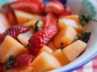 Cantaloupe Strawberry Salad with Lime Syrup and Mint - Andrea Meyers