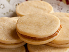 Alfajores (Dulce de Leche Sandwich Cookies) - Andrea Meyers