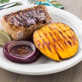 Grilled Jerk Pork Chops with Mango and Rum Sauce