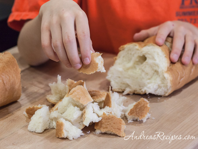Tearing bread for Butternut Squash and Parmesan Bread Pudding - Andrea Meyers