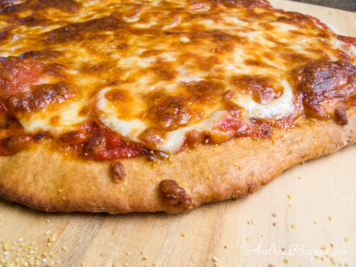 Quick Whole Wheat Pizza Dough with pepperoni and mozzarella cheese - Andrea Meyers