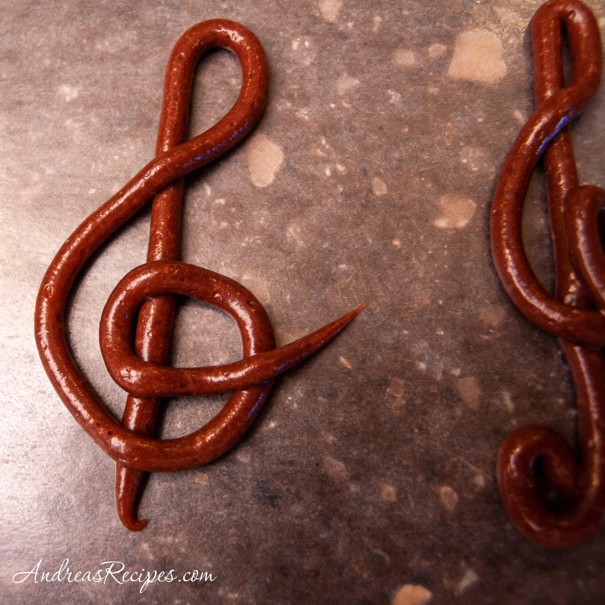 Opera cake G clefs piped with chocolate frosting - Andrea Meyers