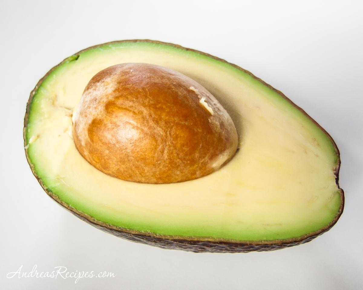 Avocado cut in half - Andrea Meyers