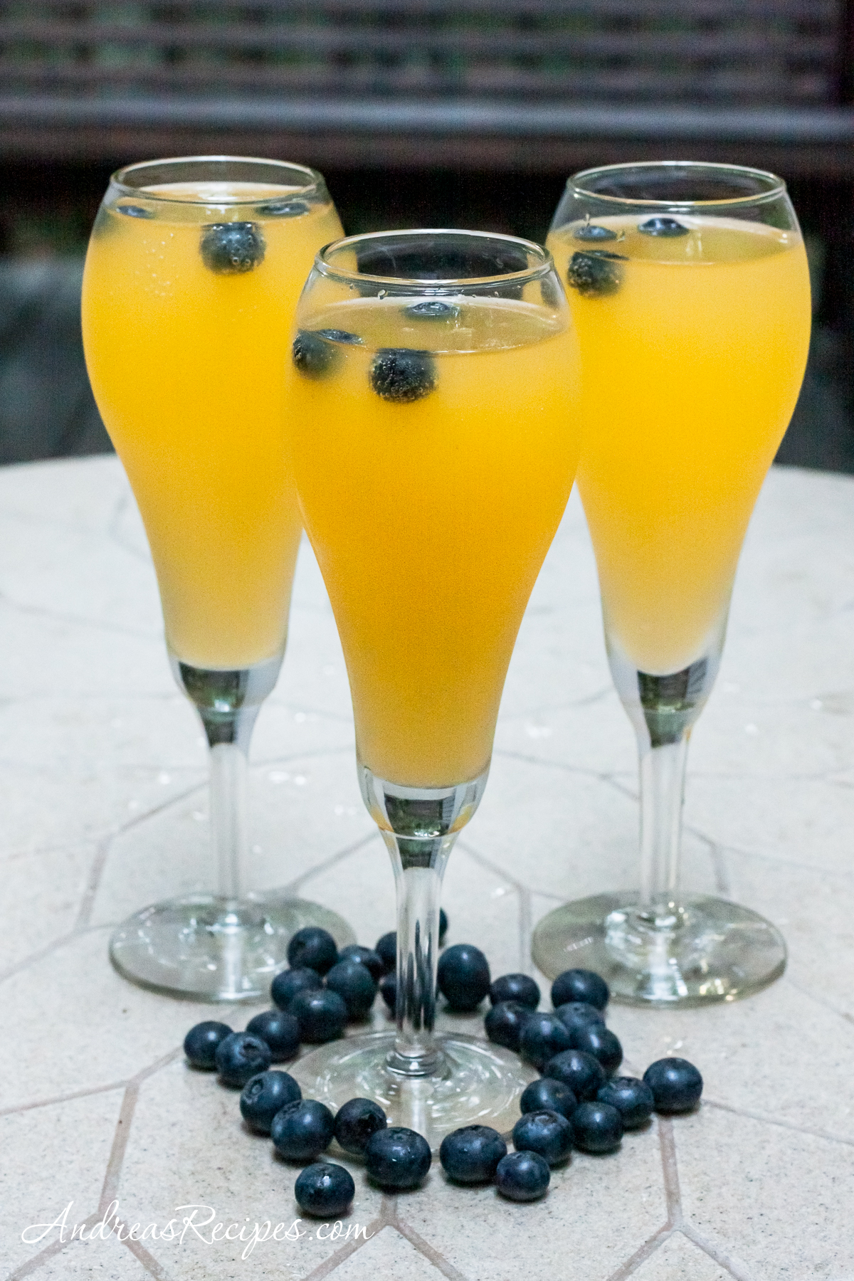 Mango Blueberry Champagne Cocktail - Andrea Meyers