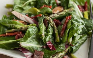 Baby Chard Salad with Asparagus, Sun-Dried Tomatoes, and Hot Bacon Vinaigrette