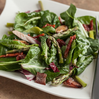Baby Chard Salad with Asparagus, Sun-Dried Tomatoes, and Hot Bacon Vinaigrette - Andrea Meyers
