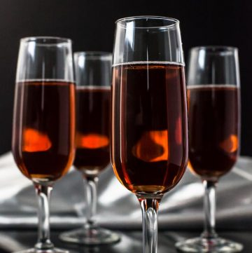 Cranberry Pomegranate Champagne Cocktail - Andrea Meyers