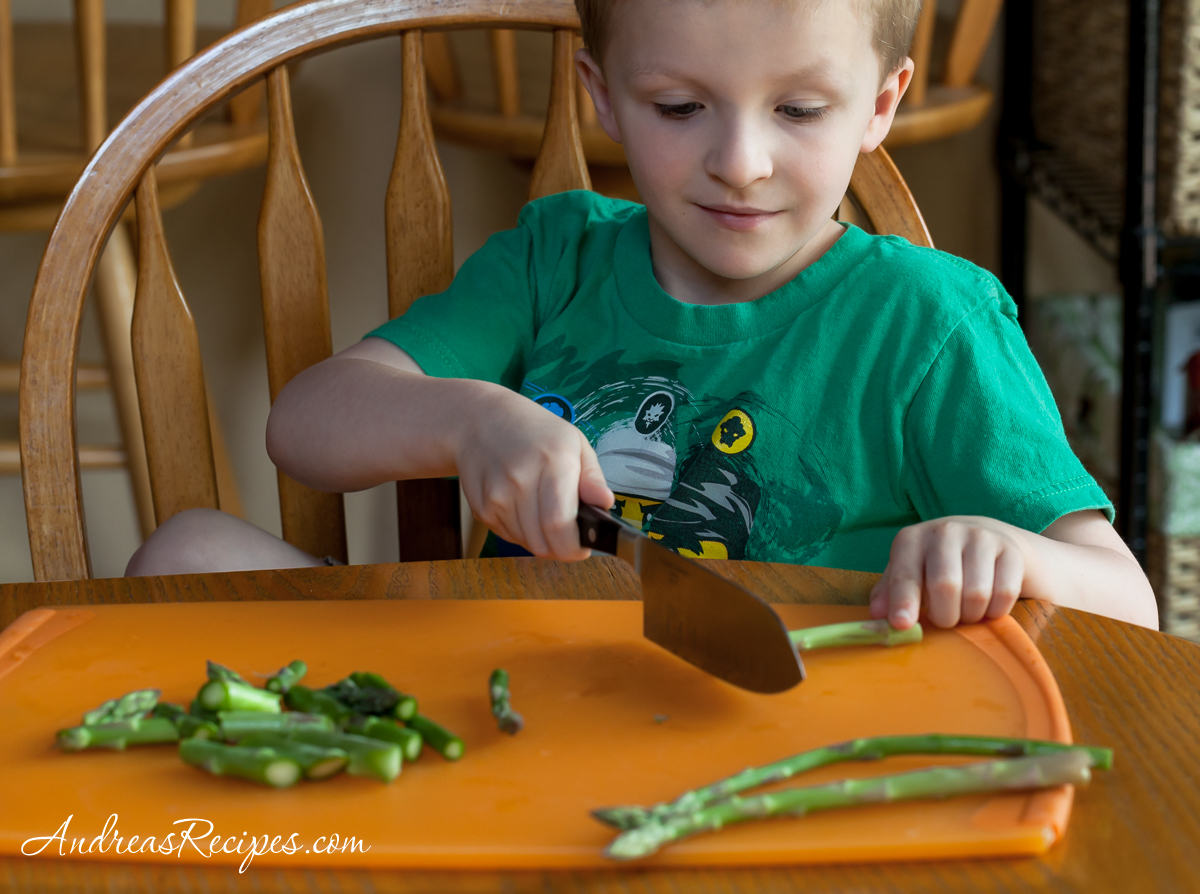 Chopping asparagus - Andrea Meyers