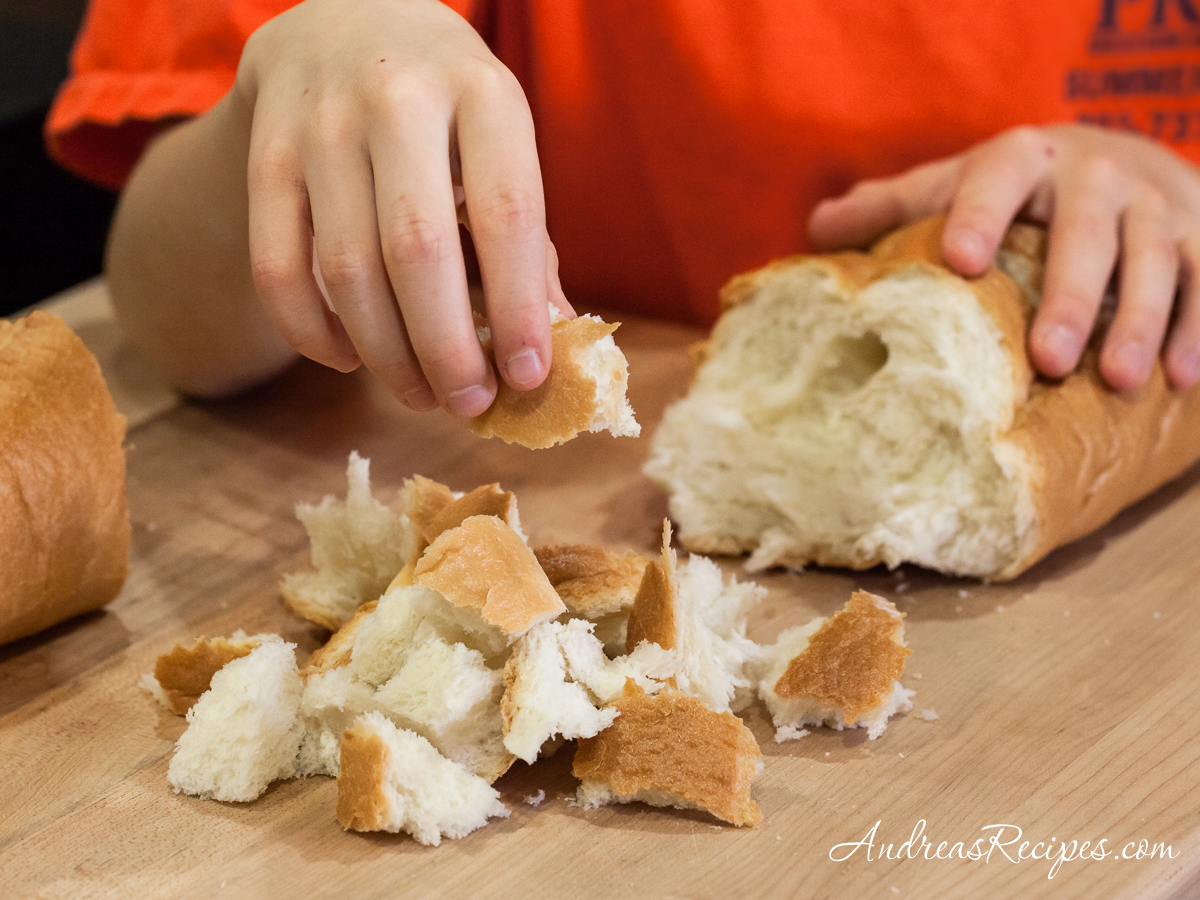 Pulling apart bread for Butternut Squash and Parmesan Bread Pudding - Andrea Meyers