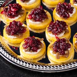 Polenta Toasts with Goat Cheese, Caramelized Onions, and Port Cranberries