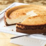Eggnog Cheesecake Recipe with Dark Rum and Biscoff Cookie Crust - Andrea Meyers