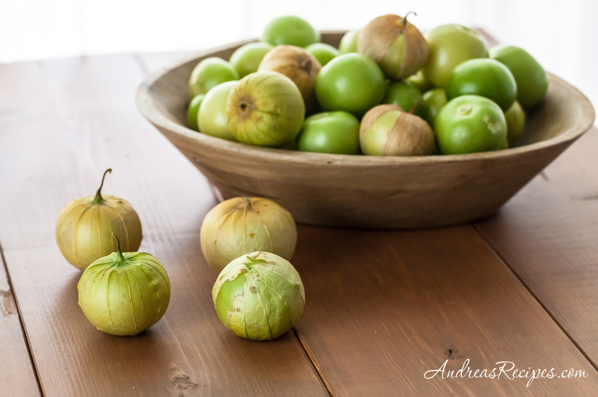 Tomatillos in a wooden bowl - Andrea Meyers
