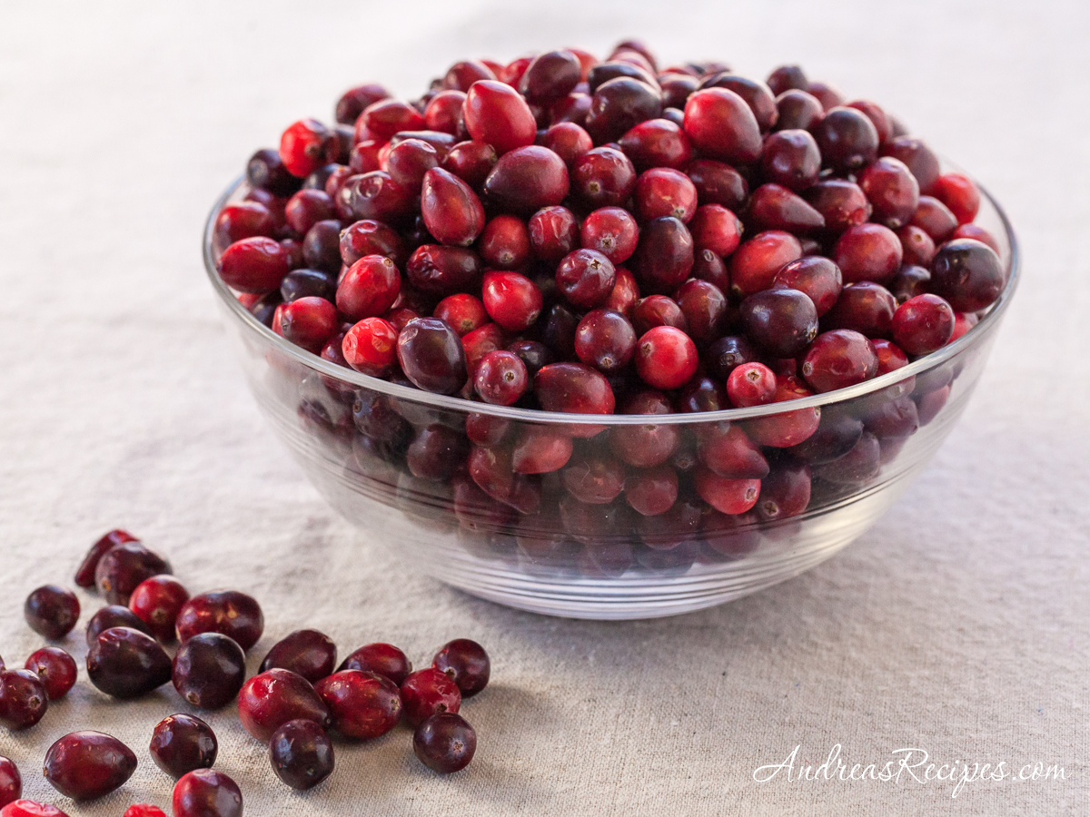 Cranberries in a glass bowl - Andrea Meyers