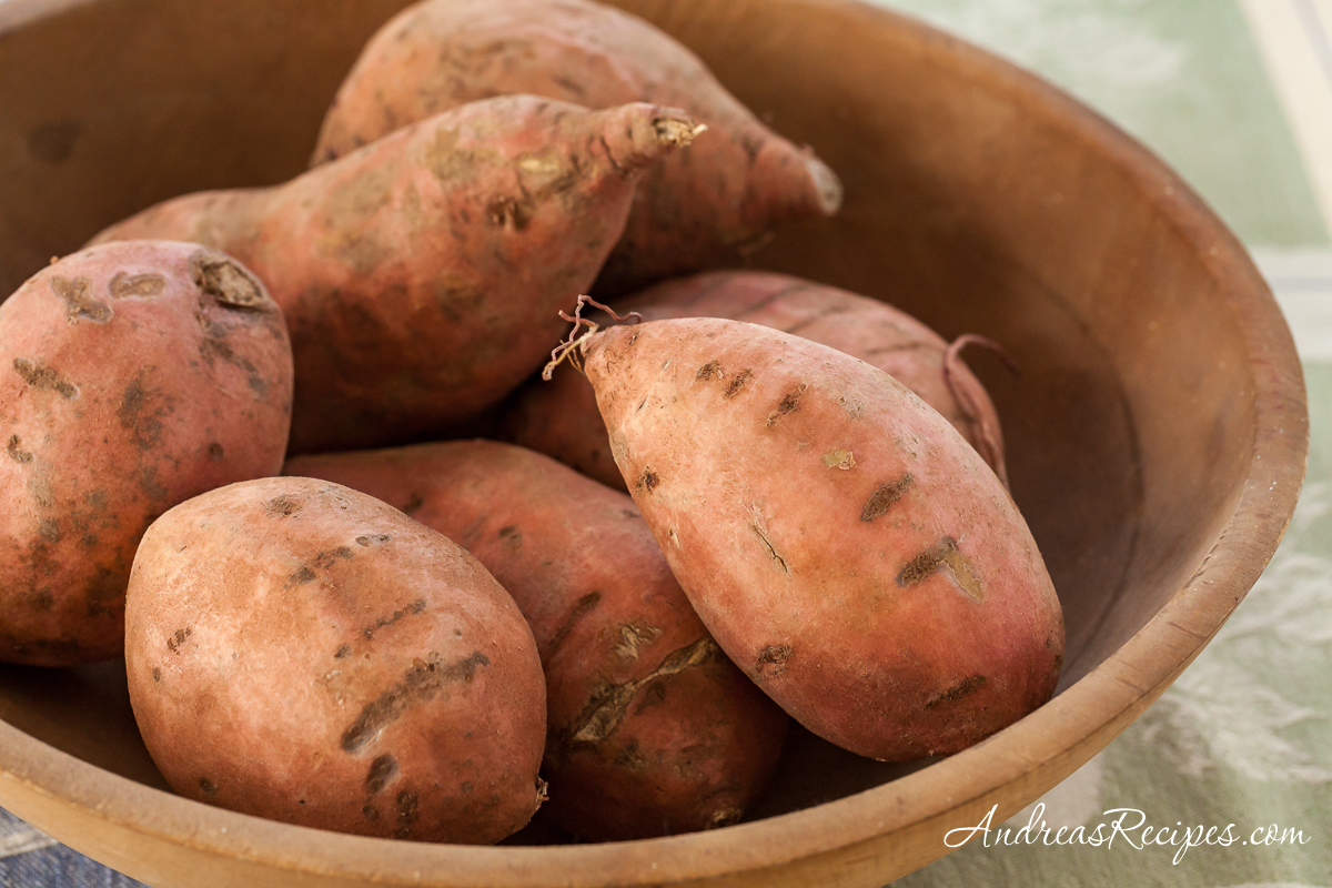 Sweet potatoes in a wooden bowl - Andrea Meyers
